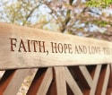 Message engraved on the top rail of a teak bench