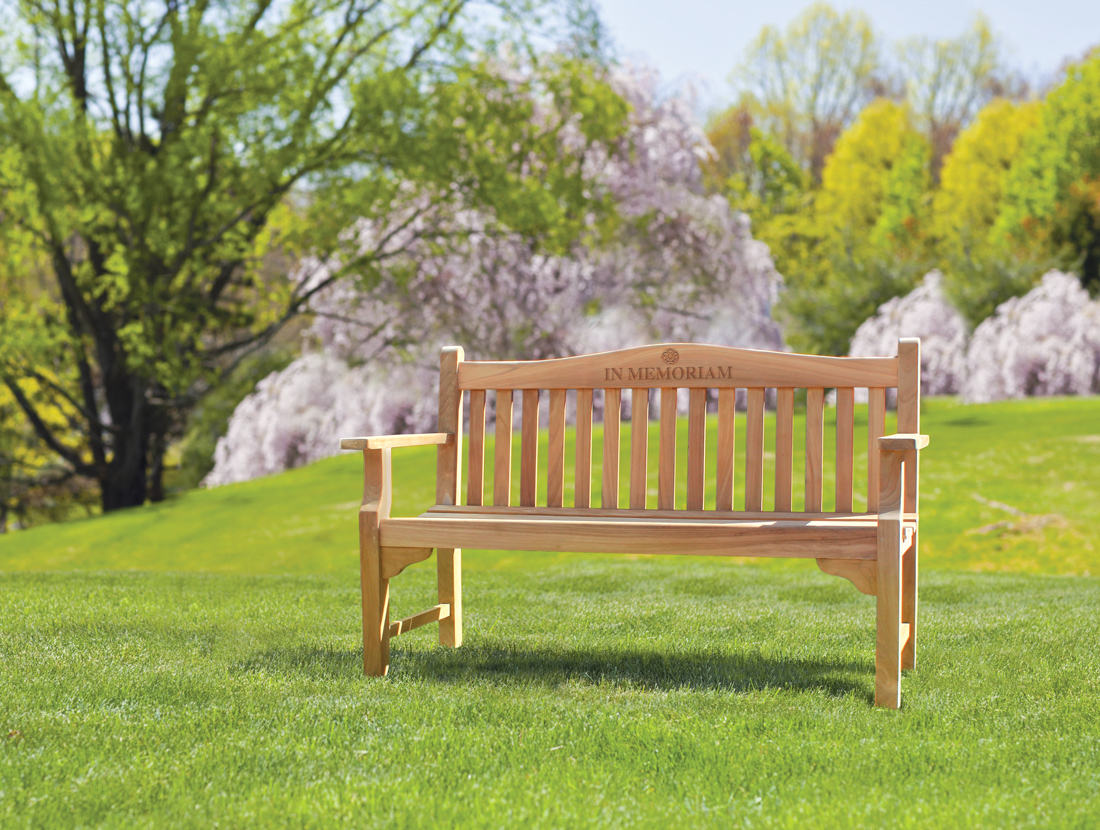 teak memorial bench in park setting.jpg